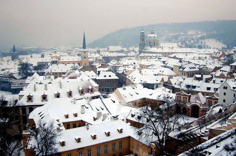 Snow over Prague roofs