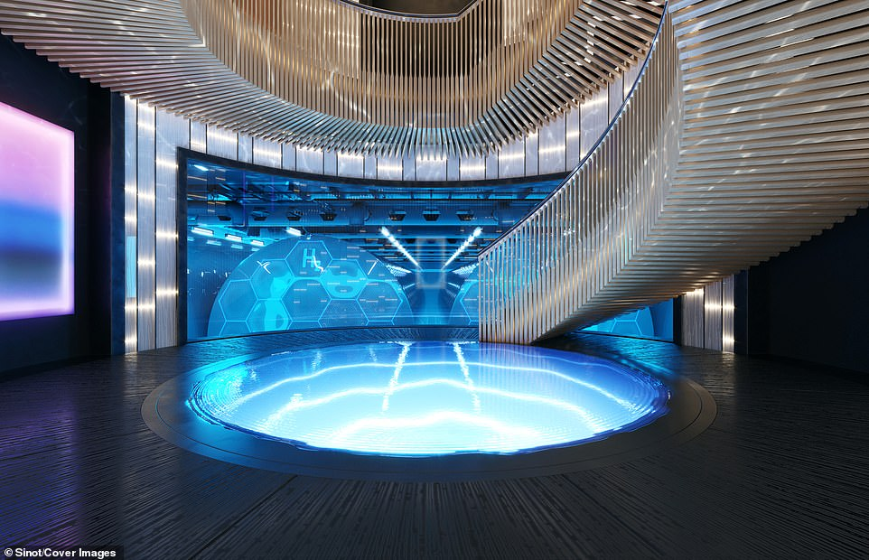 A huge staircase at the centre of the vessel spirals around a water feature (centre) to the lower level, where the ship's hydrogen fuel tanks can be viewed through a glass panel (rear). Each tank weighs 28 tons, is vacuum sealed and cooled to-423F (-253C) in order to hold the hydrogen fuel